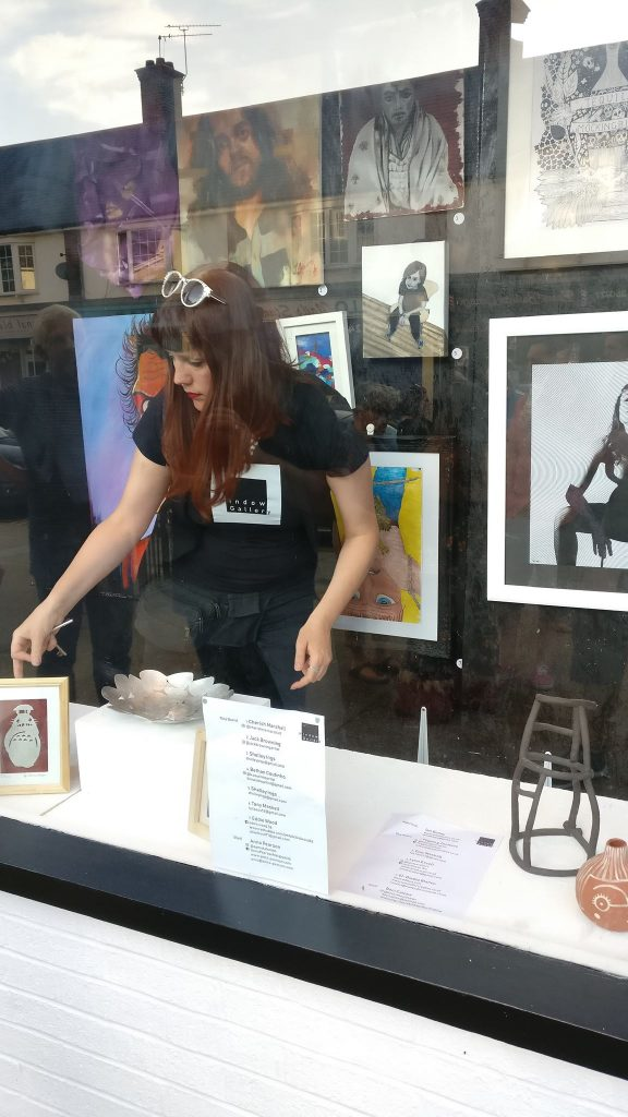 Window Gallery curator Candy Joyce adding the final touches on opening night